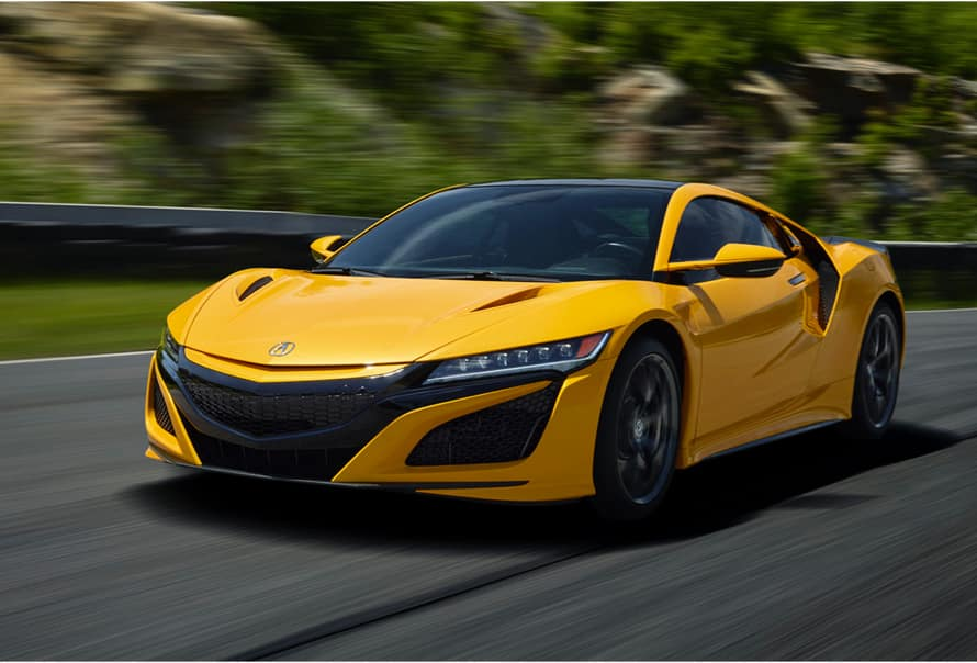 Acura Model Image - Yellow NSX driving on a road