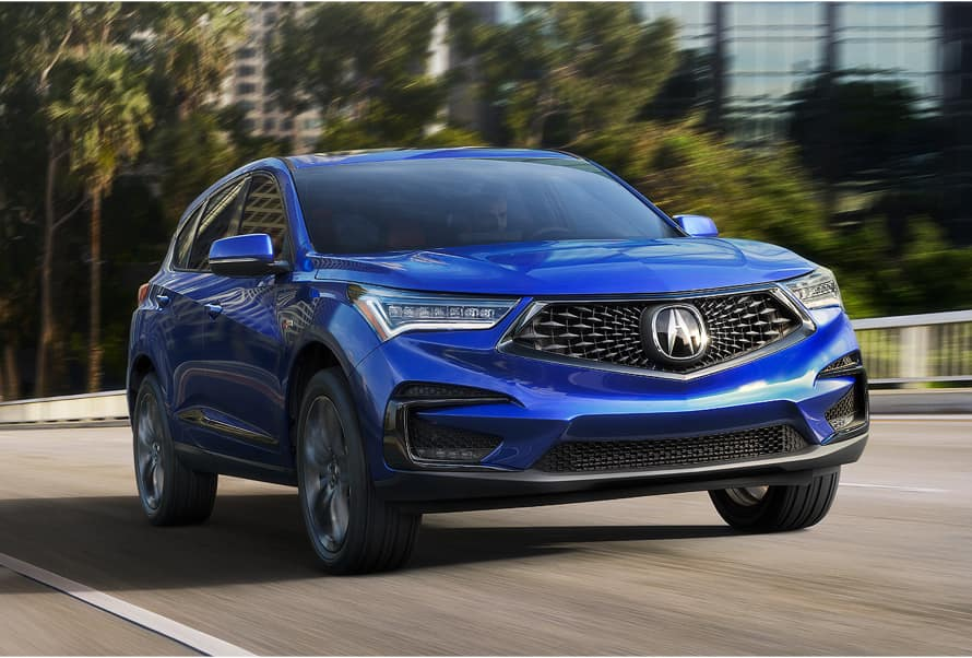 Acura Model Image - Blue RDX driving on a road