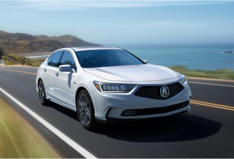 Acura Model Image - white RLX driving next to the ocean