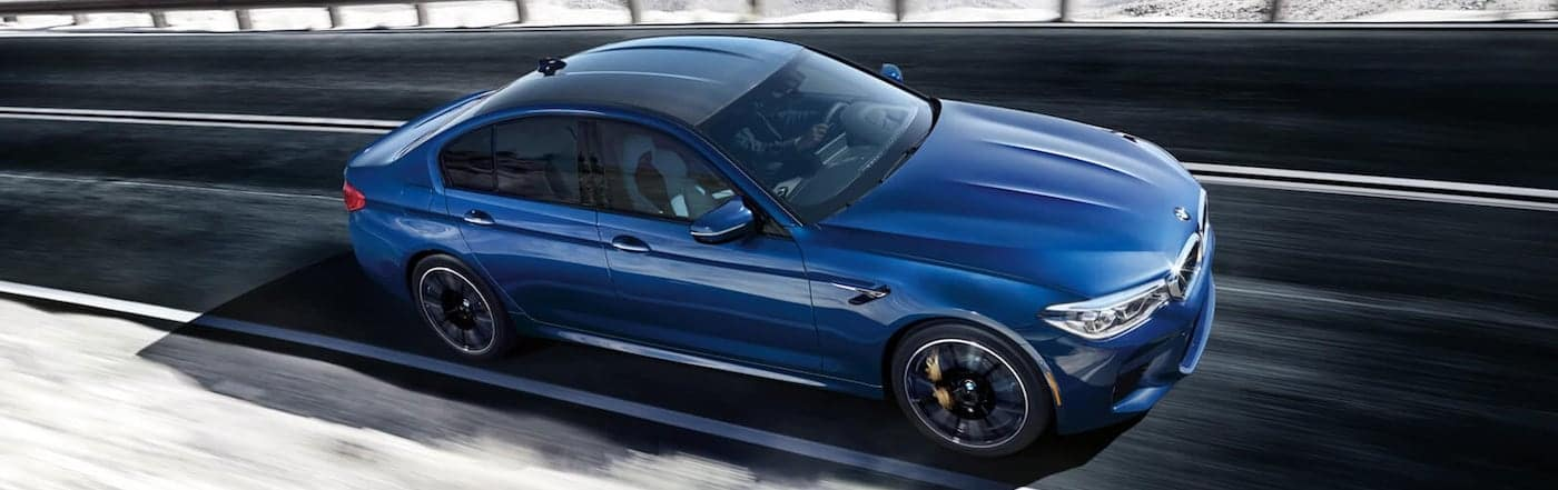 A 2020 BMW M5 cornering on a track