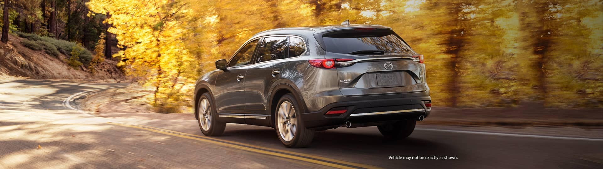 2019 Mazda CX-9 driving in autumn