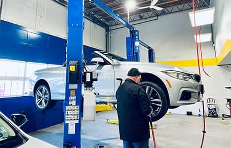 technician working on white car