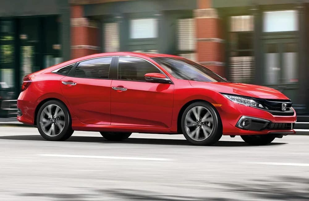 2020 Honda Civic in red driving down the road