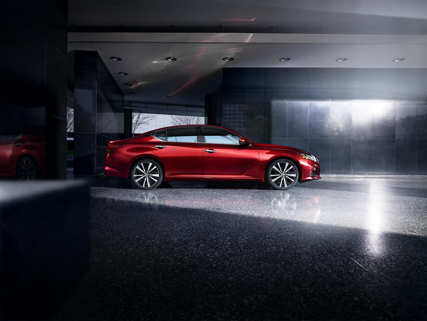 Model Features of the 2020 Nissan Altima at Hanover Nissan of Hanover | red nissan altima park inside a building