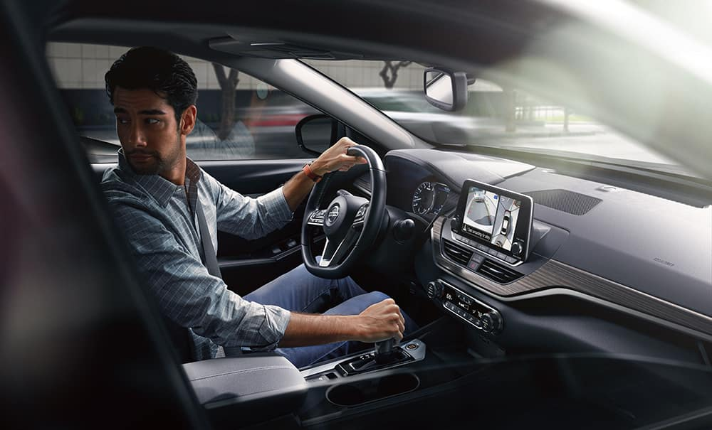 Model Features of the 2020 Nissan Altima at Hanover Nissan of Hanover | man driving the nissan altima