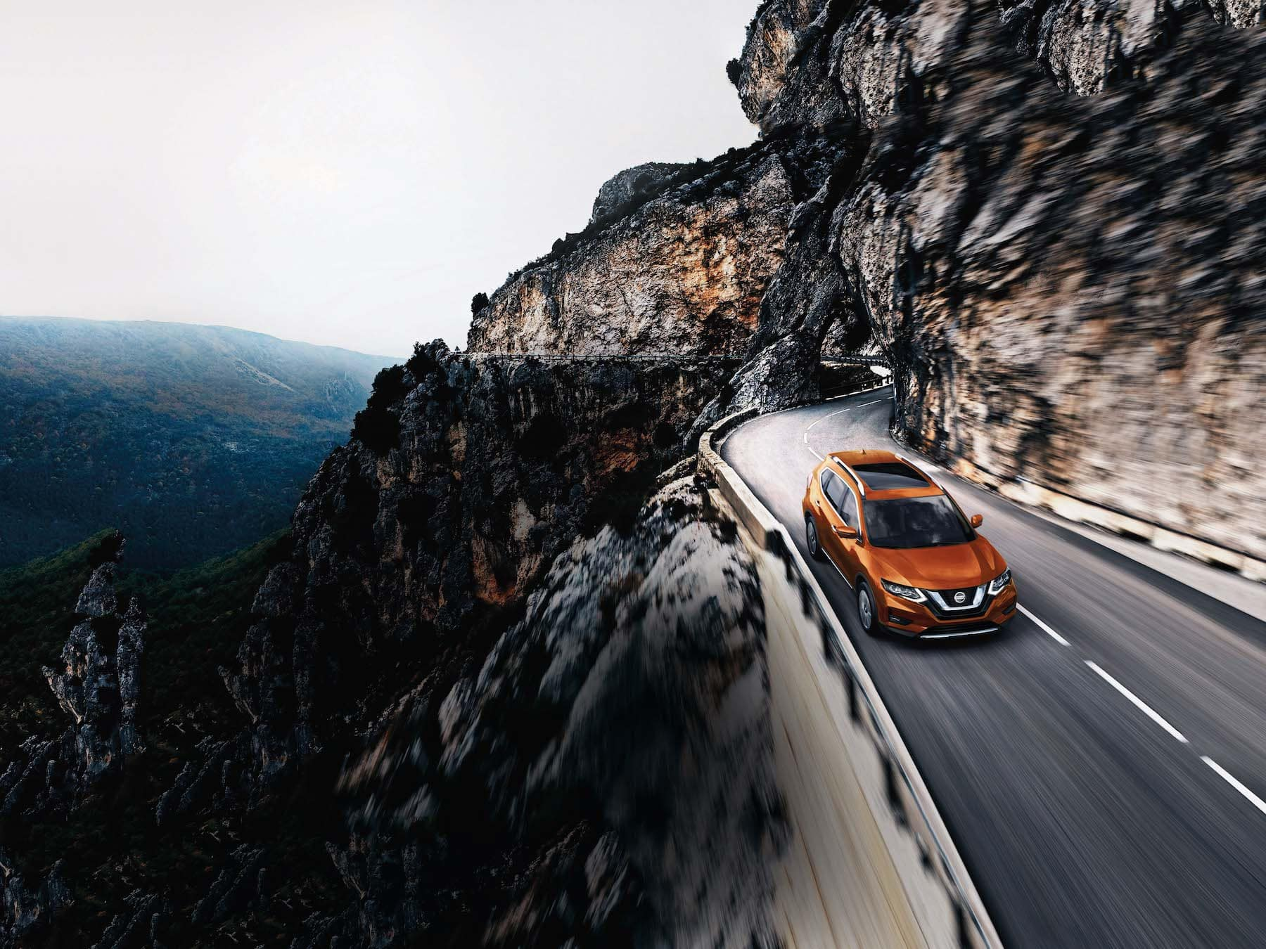 The 2020 Rogue model features at Hanover Nissan in Hanover | Orange 2020 rogue driving up the hill
