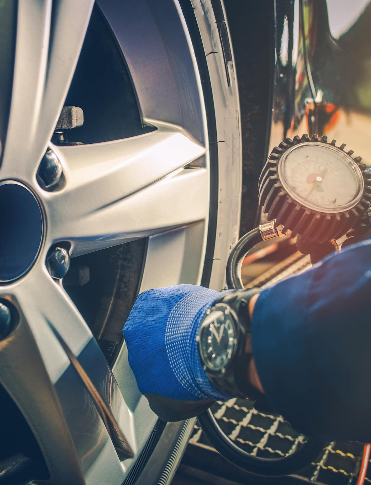 How to check your tires' health at Hanover Volkswagen | Man checking tire pressure