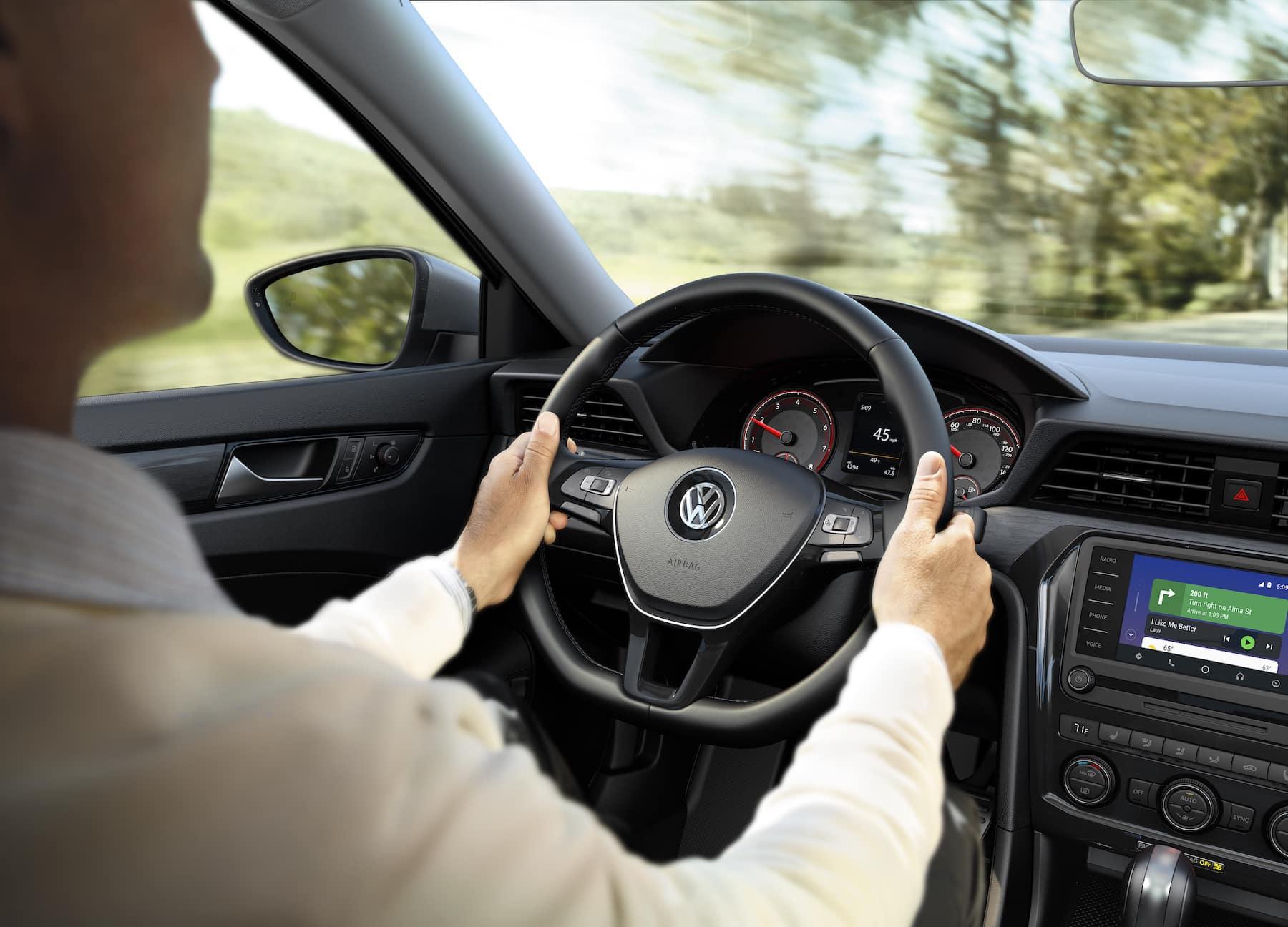 What are the model features of the 2020 Volkswagen Passat? Hanover Volkswagen | Man driving the 2020 passat