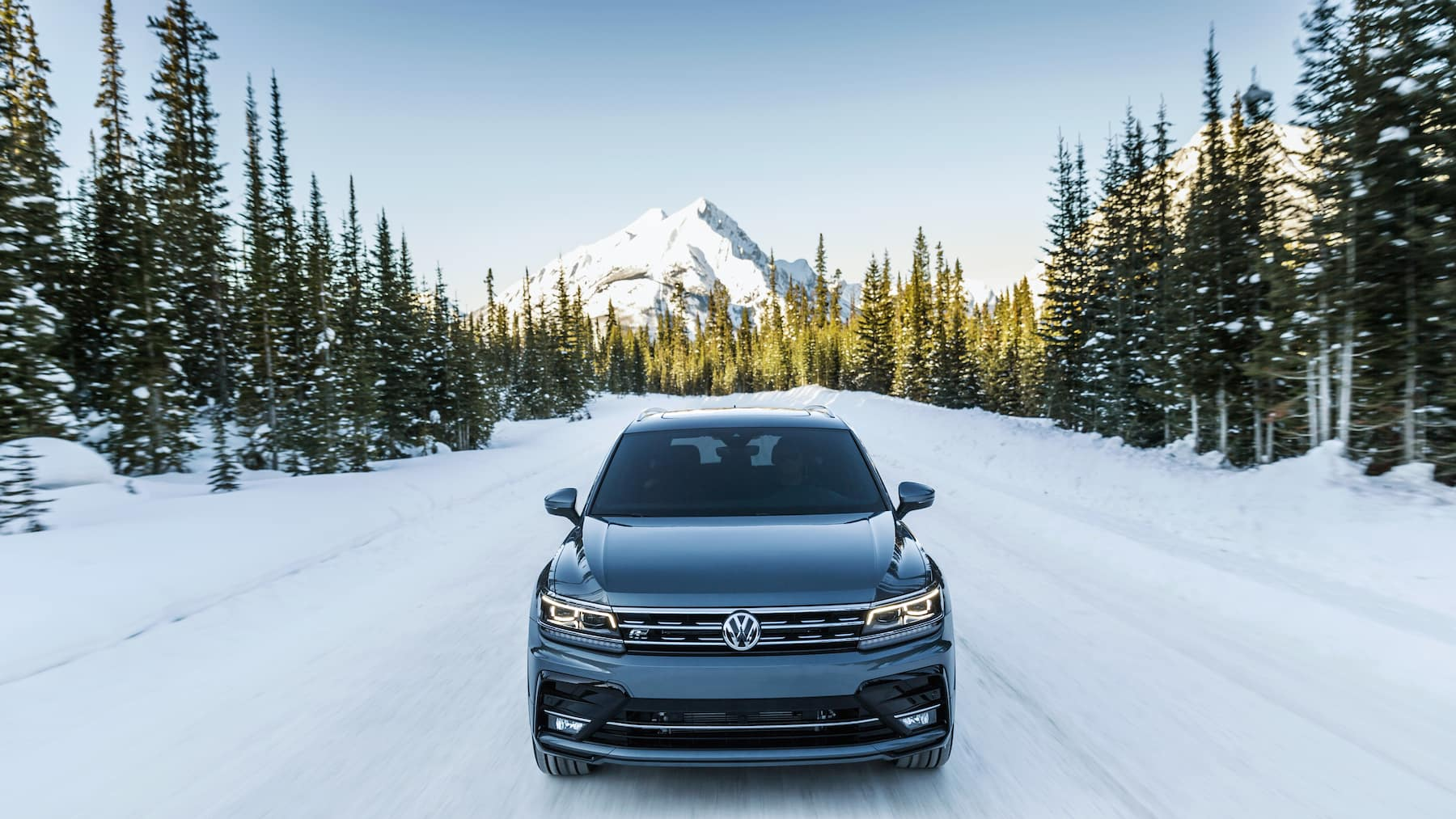 Model features of the 2020 Tiguan at Hanover Volkswagen in Hanover   grey 2020 tiguan driving on the snow