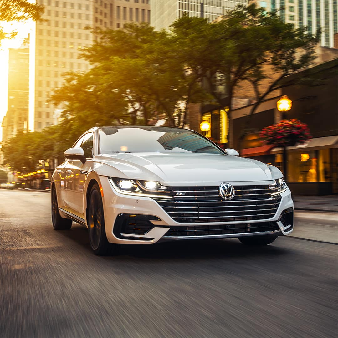 Hanover Volkswagen is a car dealership in Hanover PA near Westminster MD | White Arteon Motion Sunset City Road