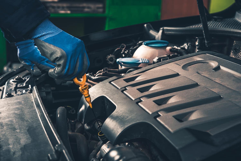 Hanover Volkswagen is a Car Dealership in Hanover PA near Finksburg MD | man checking engine oil