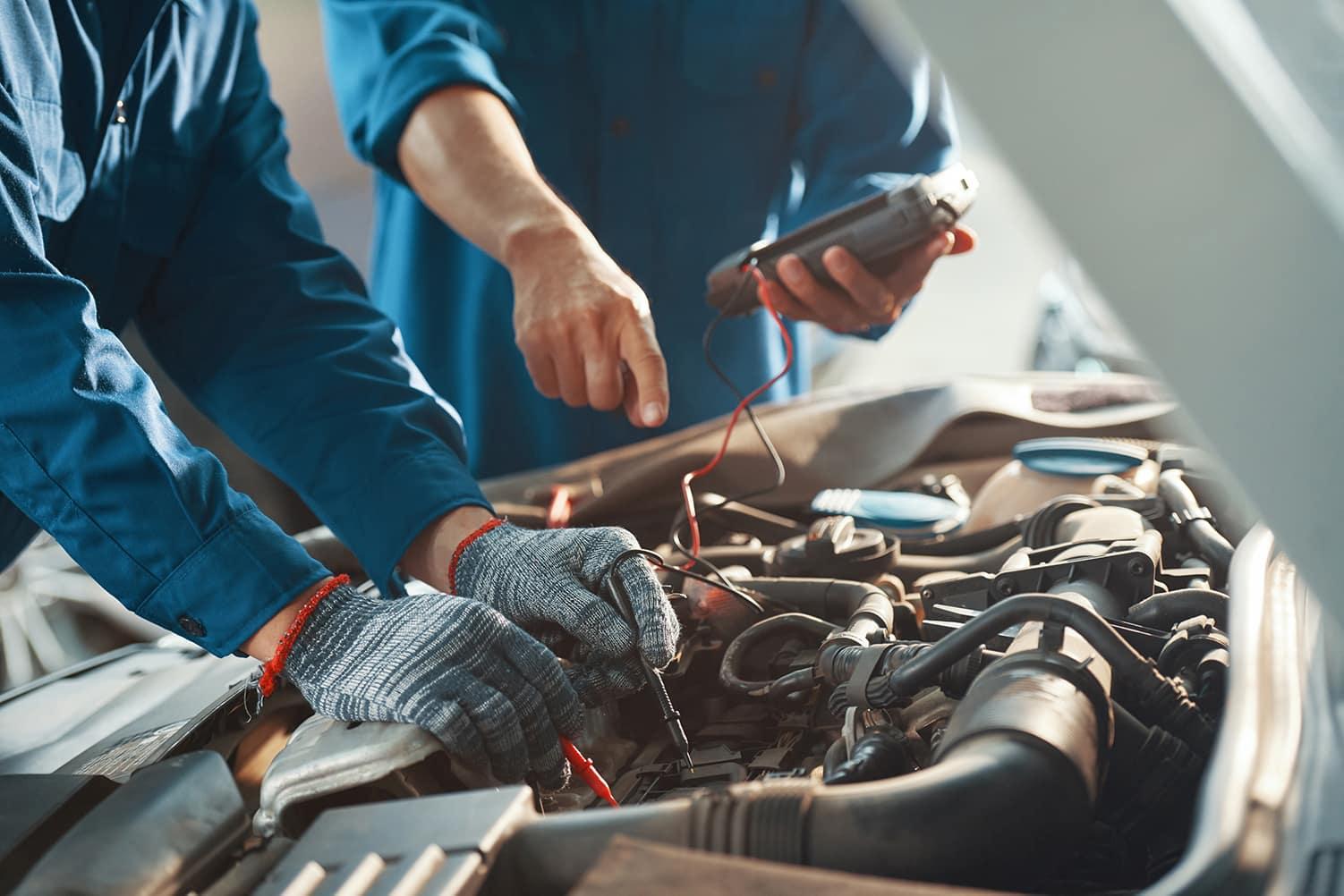 Hanover Volkswagen is a Car Dealership in Hanover PA near Finksburg MD | man testing car battery