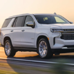 2021 chevy tahoe white exterior driving down road