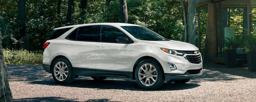 2020 chevy equinox white exterior parked outside forest home