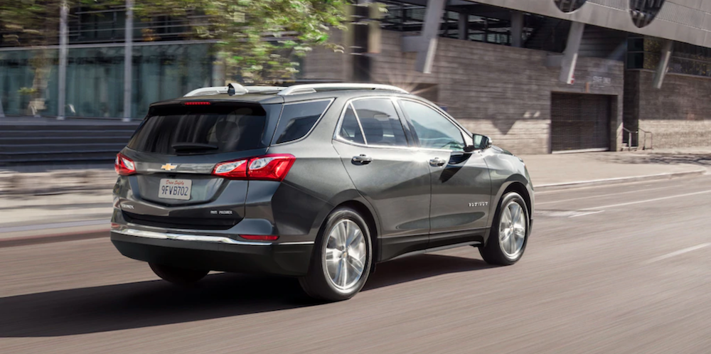 2021 chevy equinox silver exterior driving down road