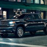 2020 chevy silverado 1500 black parked at night in city scene