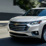 2020 chevy traverse white exterior driving through city road