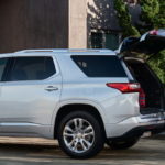 2021 chevy traverse white exterior with family