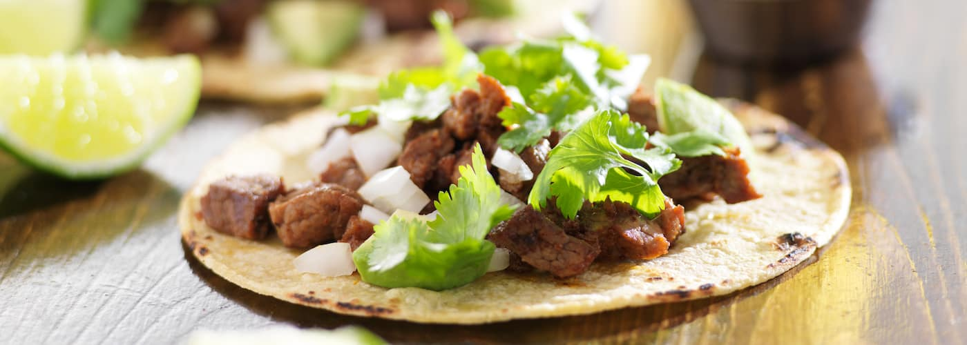 gourmet beef tacos with onion and cilantro