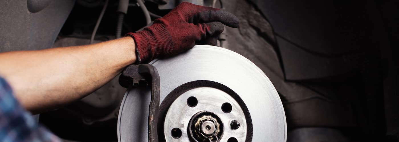 mechanic replacing brake pads close up