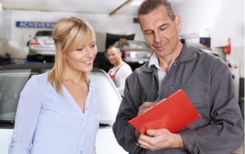 Mechanic telling woman about her car