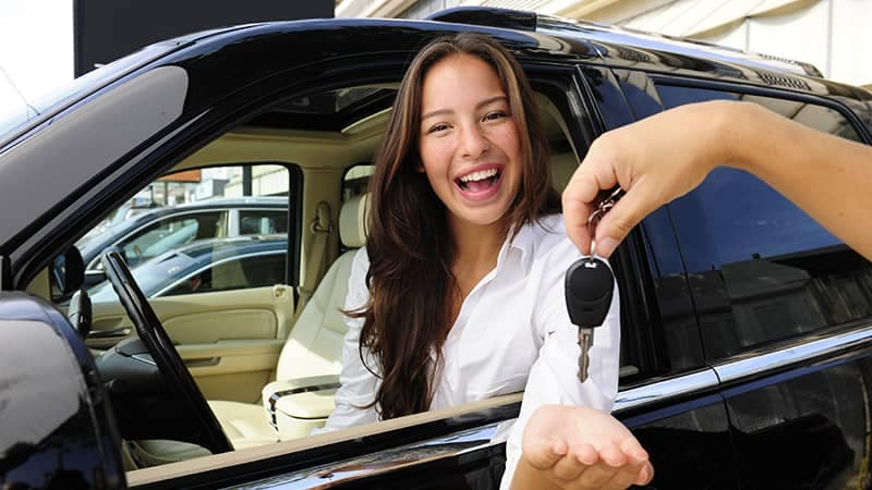 Woman excited about buying a new car