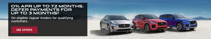 0% APR UP TO 72 MONTHS. DEFER PAYMENTS FOR UP T0 3 MONTHS. ON ELIGIBLE JAGUAR MODELS FOR QUALIFYING CUSTOMERS. SEE OFFERS. SILVER 2020 JAGUAR I-PACE, RED 2020 JAGUAR E-PACE AND BLUE 2020 JAGUAR F-PACE DRIVING SIDE BY SIDE THROUGH DESERT.