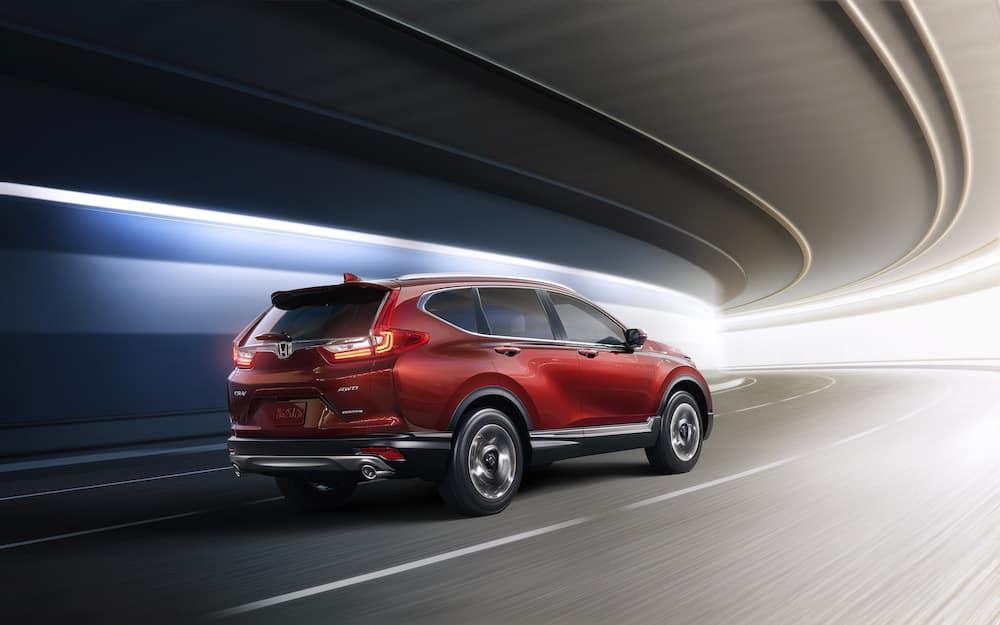 2019 Honda CR-V features at Jim Coleman Automotive dealerships in Maryland | Red Honda CR-V running on road