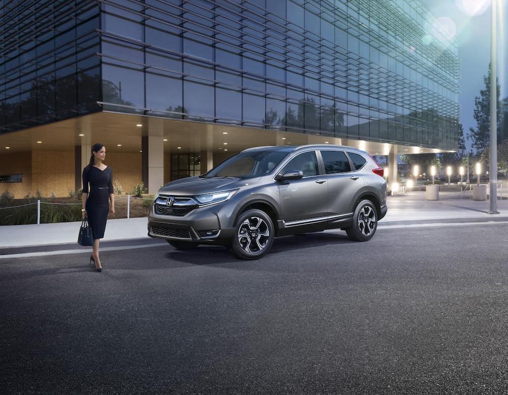2019 Honda CR-V features at Jim Coleman Automotive dealerships in Maryland | Woman walking infront of a gray Honda CR-V