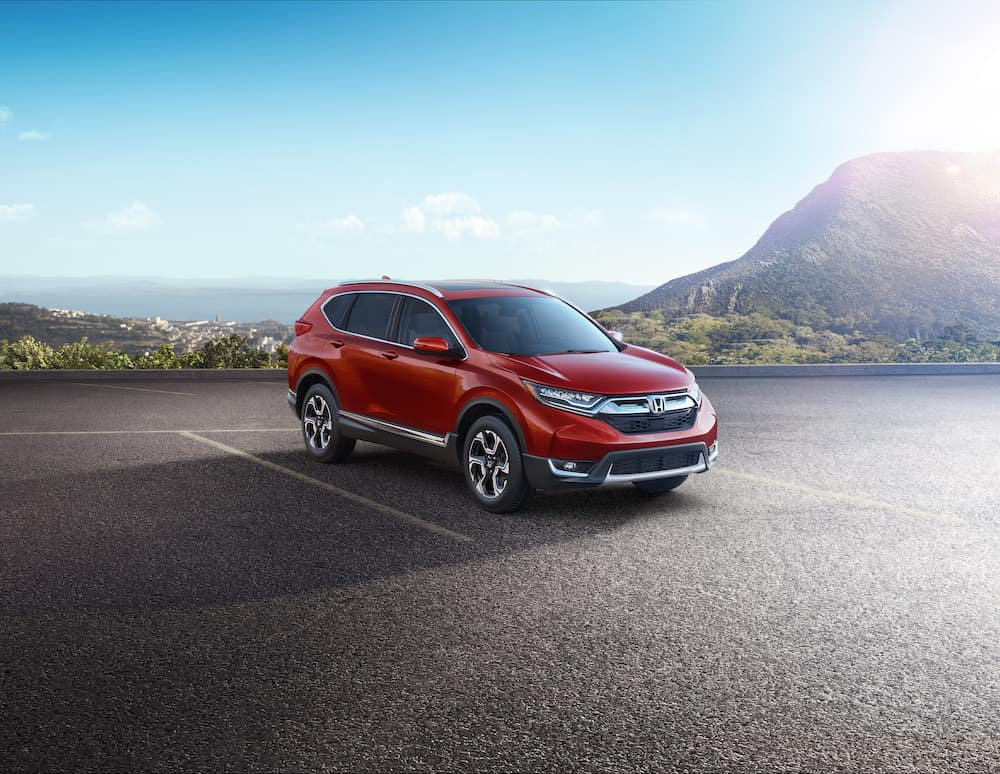 2019 Honda CR-V features at Jim Coleman Automotive dealerships in Maryland | Red 2019 Honda CR-V parked in parking lot
