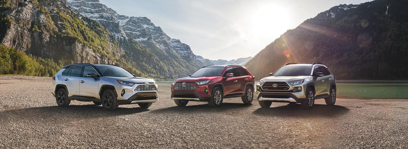 Performance features of the 2019 Toyota RAV4 at Jim Coleman Automotive | Sliver, red, white Toyota RAV4 parked on ground