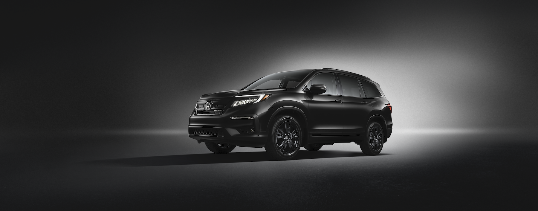 Model Features of the 2020 Honda Pilot at Jim Coleman in Maryland | Black 2020 honda pilot on a black background