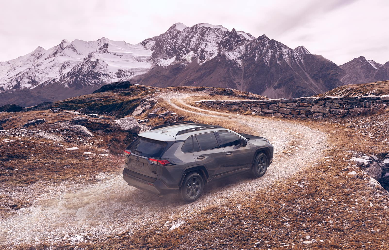 Performance features of the 2020 Toyota RAV4 at Jim Coleman | grey 2020 drving up the hill