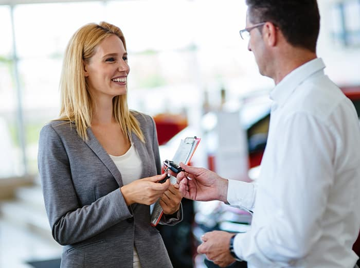 money factor explained at Jim Coleman Auto Group in Maryland   sales agent helping client