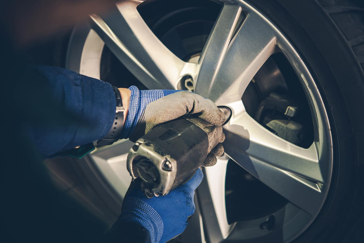Jim Coleman Automotive is a Luxury Auto Group in Bethesda near Washington DC | Tightening up the wheel after allignment