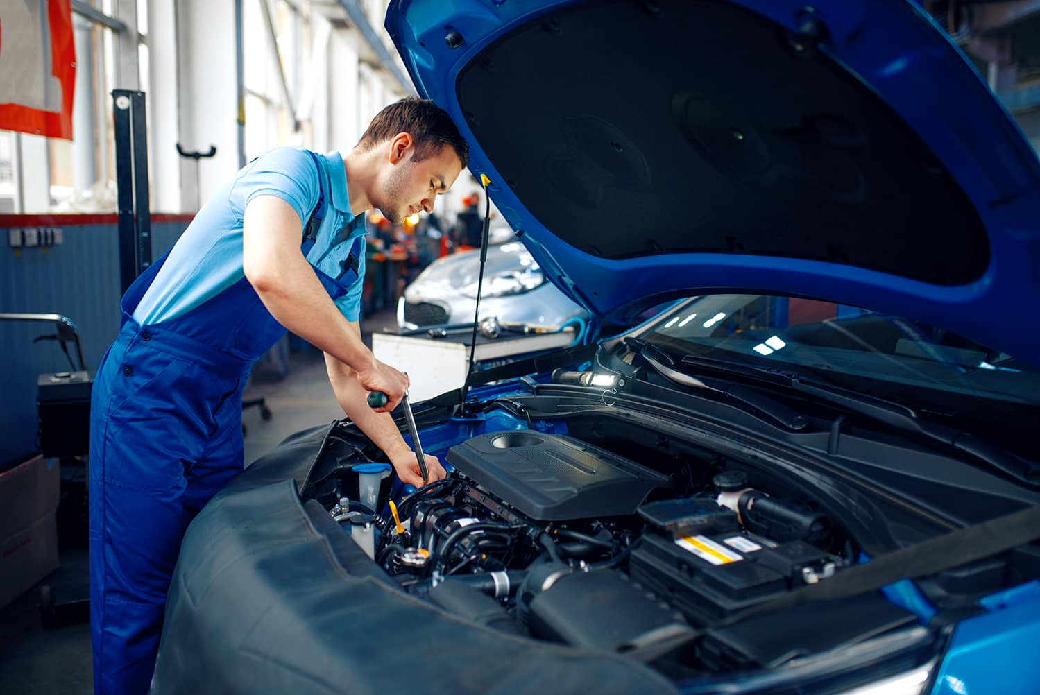 Jim Coleman Automotive is a Luxury Auto Group in Bethesda near Washington DC | Man working under hood of car