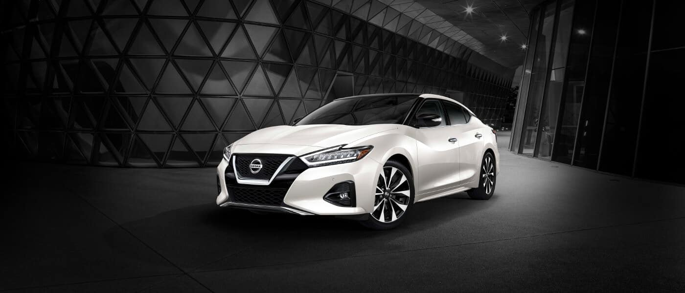 A white 2020 Nissan Maxima parked in a structure