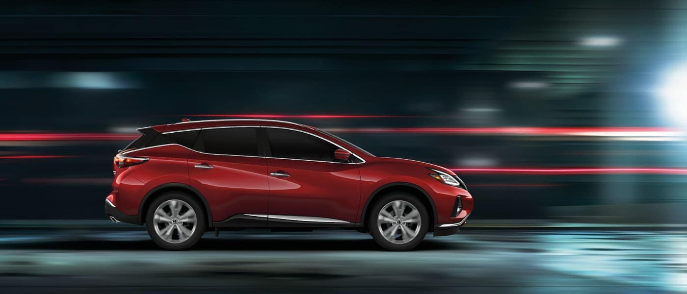 A red 2020 Nissan Murano driving down a street fast