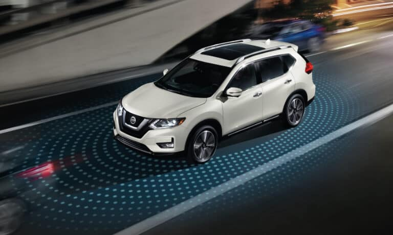 A white 2020 Nissan Rogue sensing the object around it