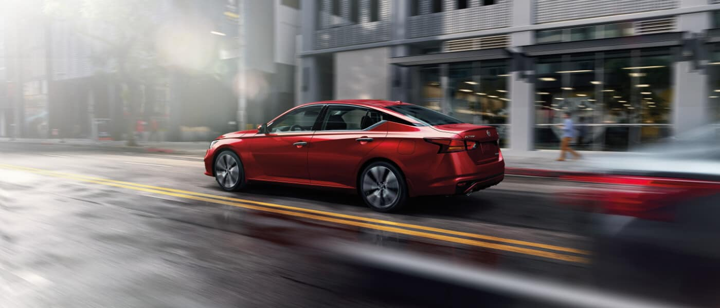 2020 Nissan Altima driving down a road