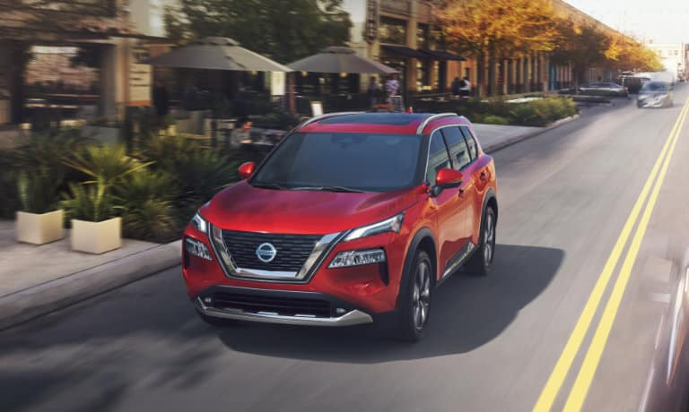 2021 Nissan Rogue driving on a suburban road