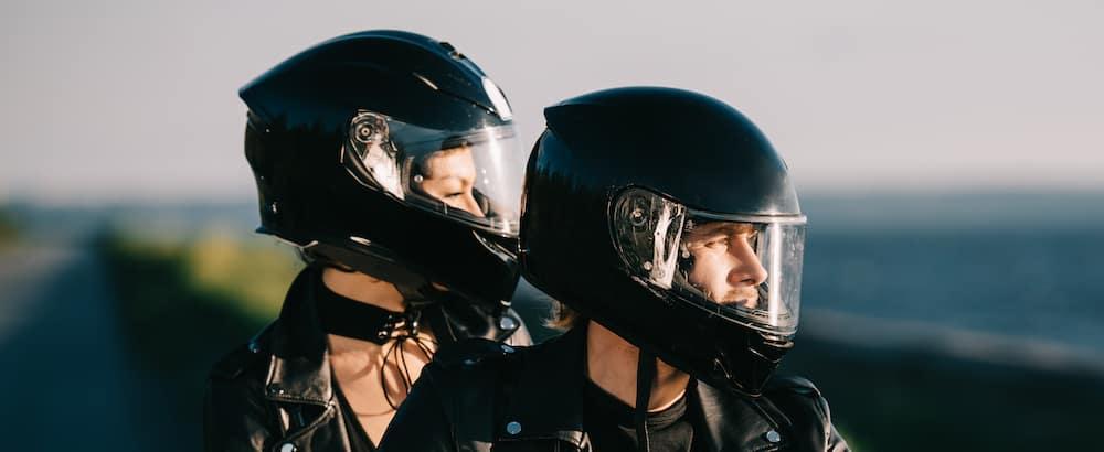 Two Motorcycle Riders in Helmets