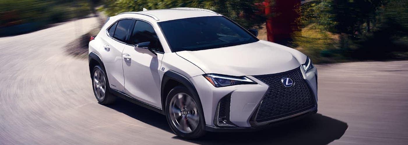 White 2020 Lexus UX Hybrid Turning Corner
