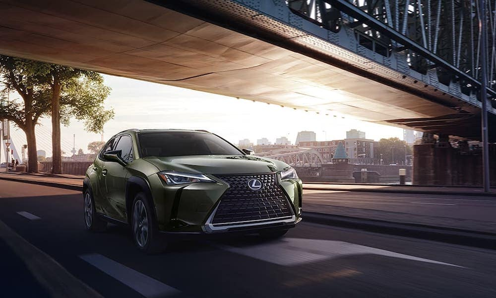 Green 2020 Lexus UX Driving Under Bridge