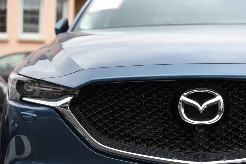 Front grille of a Mazda with Mazda logo