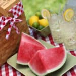 Picnic basket with watermelon and lemonade