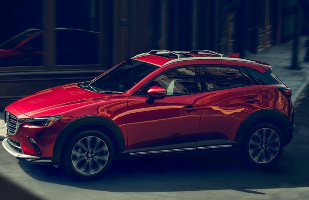 red Mazda cx-3 in a city setting