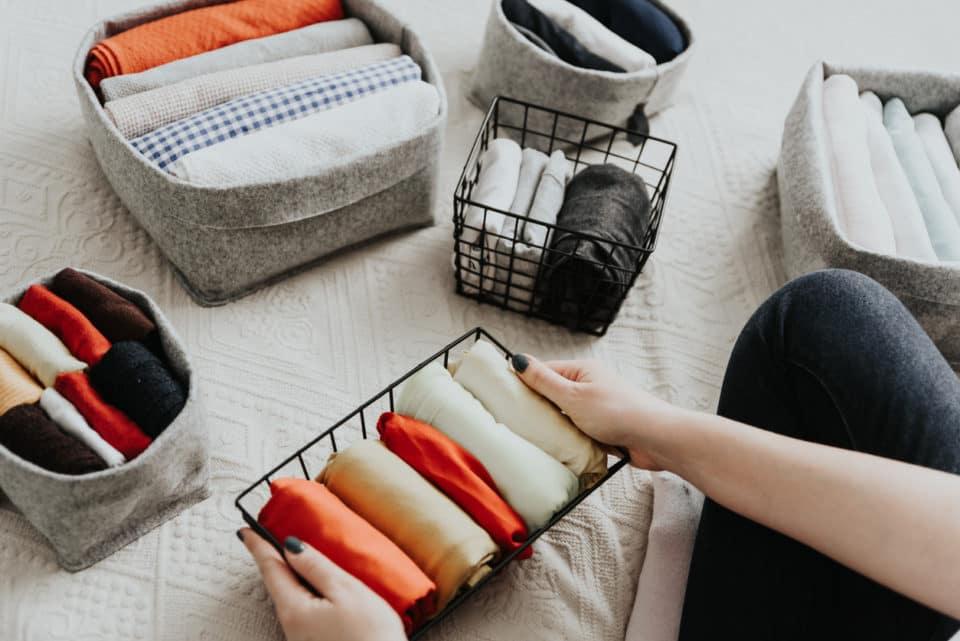 Woman folding and organizing wardrobe