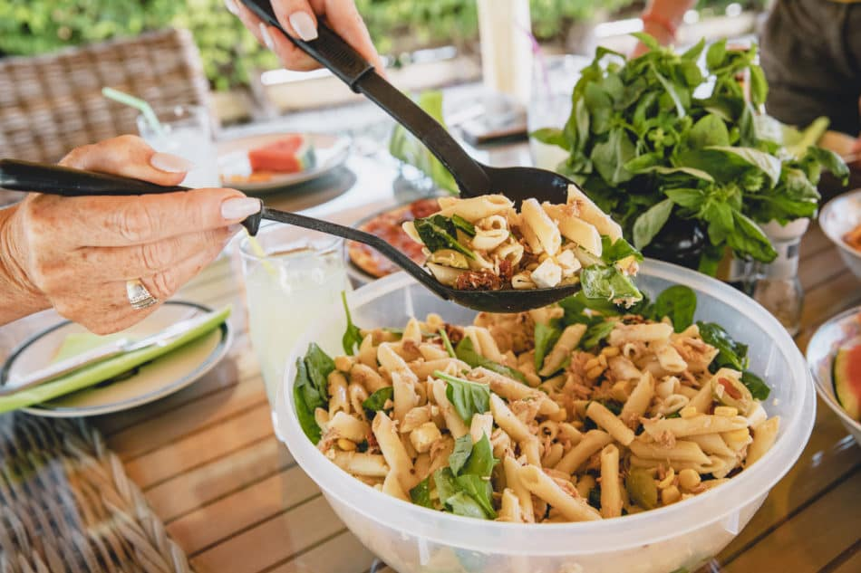 Woman serving pasta salad on a summer day