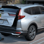 2020 Honda CR-V with man loading flowers into trunk